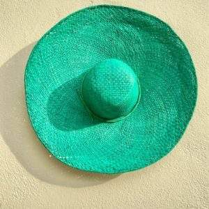 Bright green raffia straw hat