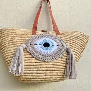 Straw tote basket with crochet evil eye